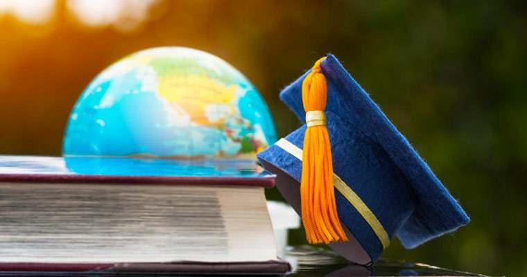 Image of USA graduation hat and globe
